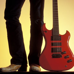 red electric guitar and cowboy boots